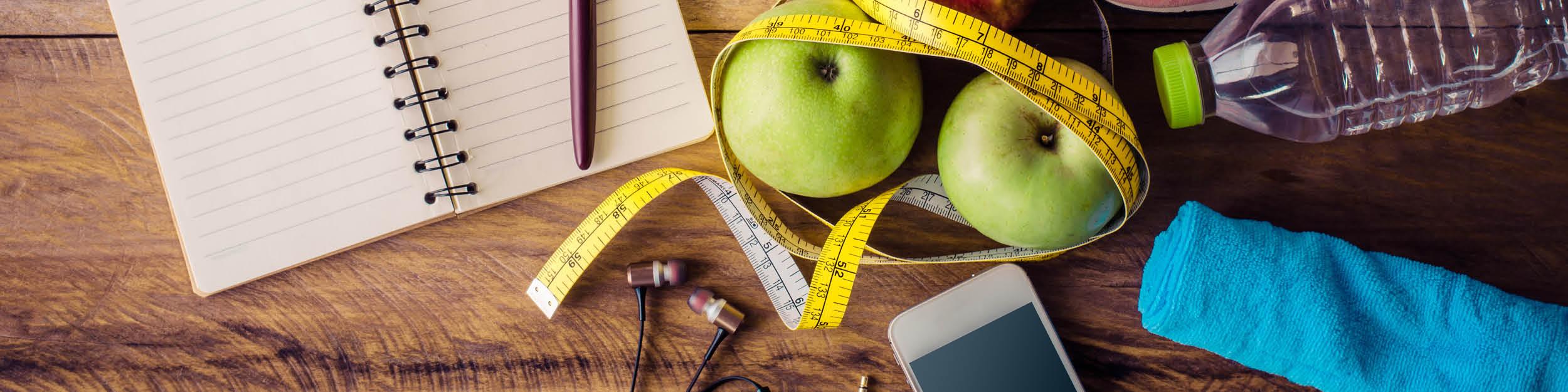 Exercise Notebook Pen Apples Tape Measure Towel Water Phone Headphones